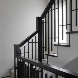 Modern Staircase with Custom Metal Baluster in an Urban Classic Chicago Home