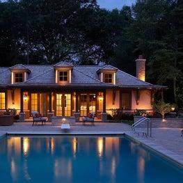 Arts and Crafts Stucco Pool House with Shingle Roof & Wood Brackets