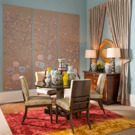 Beautiful hand painted DeGournay panels mixed with yellow dining chairs