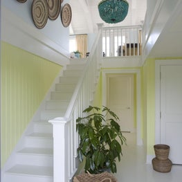 Entrance foyer with gloss-white floors and citrus bead-board brings excitement.