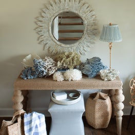 Layers of rattan and wicker give this beach house entryway a sense of nostalgia
