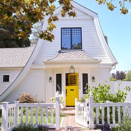 Cozy and quaint shingled cottage with yellow dutch door