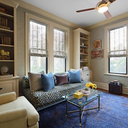 This traditional library / guest room features rich textures and Asian accents