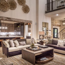 Modern and rustic combine in this fabulous custom built home with exposed beams