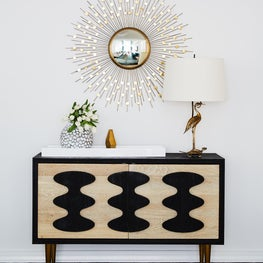 Upper East Side Entry with console starburst mirror, bird lamp and accessories