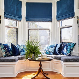 Coastal living room window bench seating in blues