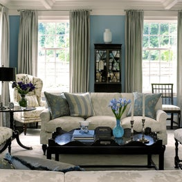 A blue & cream color scheme blend seamlessly in this traditional living room.