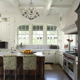 This kitchen renovation pays homage to the homes rich history and detailing