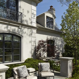 Beautiful Stucco and Bluestone Terrace with Arched window backdrop