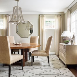 Transitional dining room with beaded chandelier in Hillsborough residence.