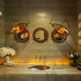 Blown glass pendants over custom vanity