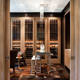 Wine Cellar with Leather Wrapped Cabinets
