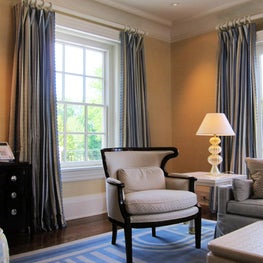 A quaint sitting room in this Pennsylvania home gets custom drapes as well as matching custom hardware.
