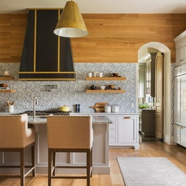 Horse Meadow country house with custom steel and brass venthood and handpainted Walker Zanger tile walls.
