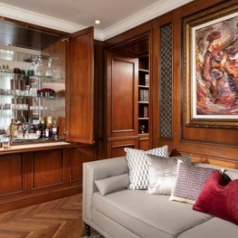 Exquisite and stylish built-in bar in home-library, perfect for entertainment.