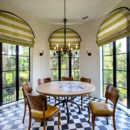 Circular Game Room with Arched Steel Windows and Eased Plaster Edges