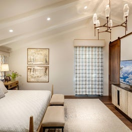 Spanish Colonial Equestrian Estate, light, warm and monochromatic bedroom furnishings