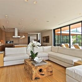 Off whites fabrics and natural oak wood tones run though this waterfront home.