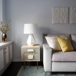 Upper East Side Family Room with two-tone sofa, angular lamp and colorful pillow