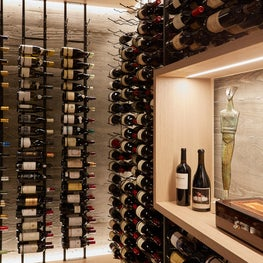 Modern Wine Cave - Wood Stamped Concrete Walls, LED lights, custom cabinetry