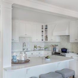 White and bright kitchen with clean architectural detailing