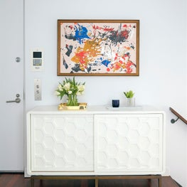 West Village Triplex Hallway with console, kids' painting and accessories