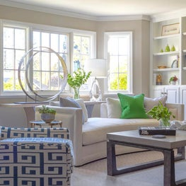Redecorated living room with custom wood and metal console with pops of color
