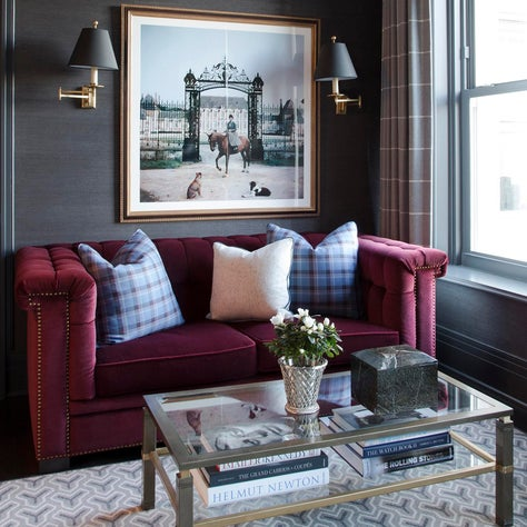 Sitting room with black walls, burgundy velvet sofa