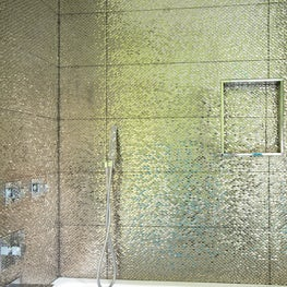 Extravagant sparkle walls line this shower.