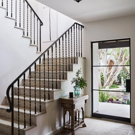 stairs with French limestone and custom design railing.