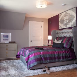 A wing-backed bed lends a sense of privacy and coziness to a feminine bedroom.