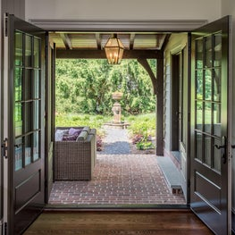 Family Room french doors to Covered Terrace & Formal Gardens in Greenville, DE