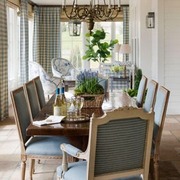 Contemporary farmhouse dining room with bronze chandelier