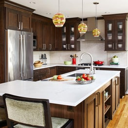 Newly reimagined functional kitchen with island sink and range hood