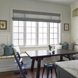 Breakfast eating area in white kitchen, antique Asian table, metal stools, teal