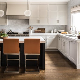 Open kitchen with neutral tones and bold accents.