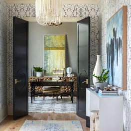 New Traditional Residence library pass through featuring Lindsay Cowles wallpaper, custom doors and original art.