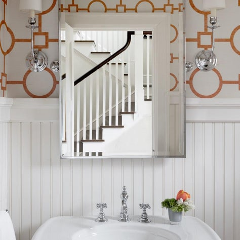 Graphic grasscloth with beadboard and classic bath fixtures