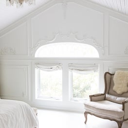 Architectural Moldings in an All White Bedroom