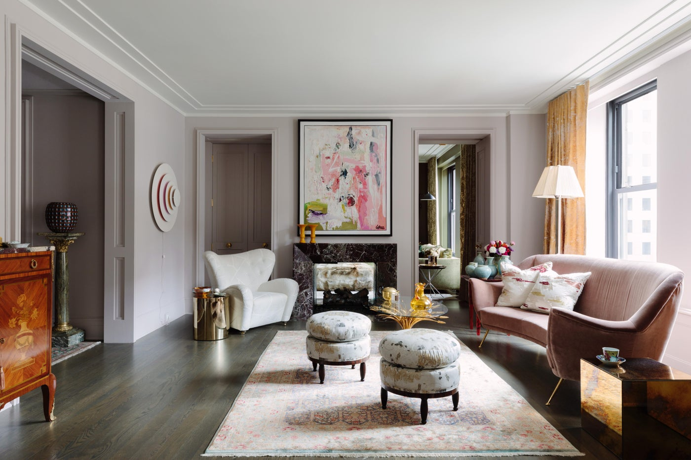 Eclectic Living Room with pink walls, marble fireplace, and abstract art