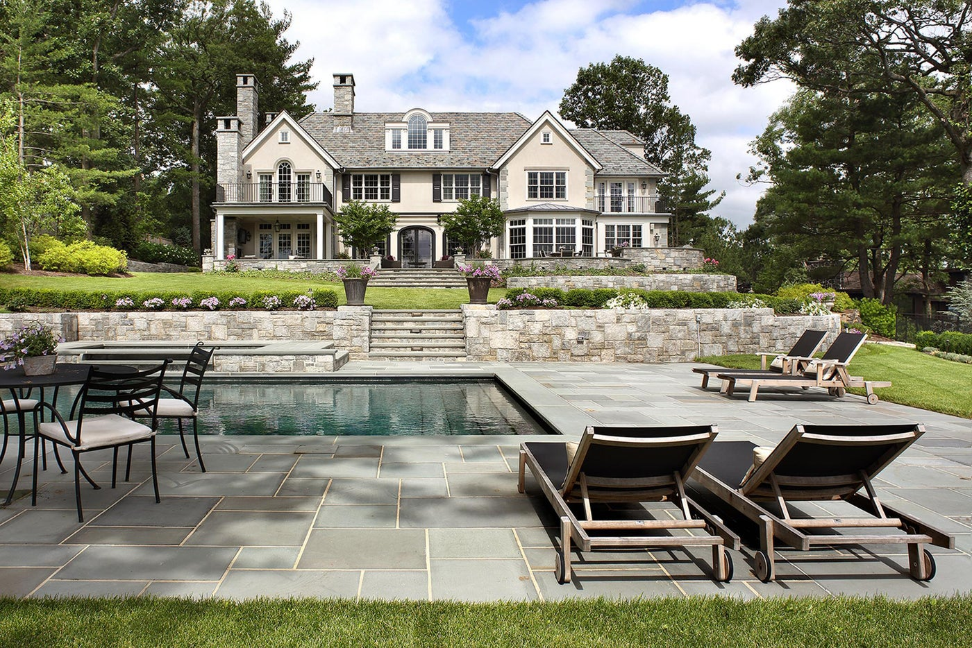 Exterior Oasis with pool, stone patio and city views