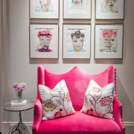 Modern girls sitting area with portrait collage & velvet settee in bold colors