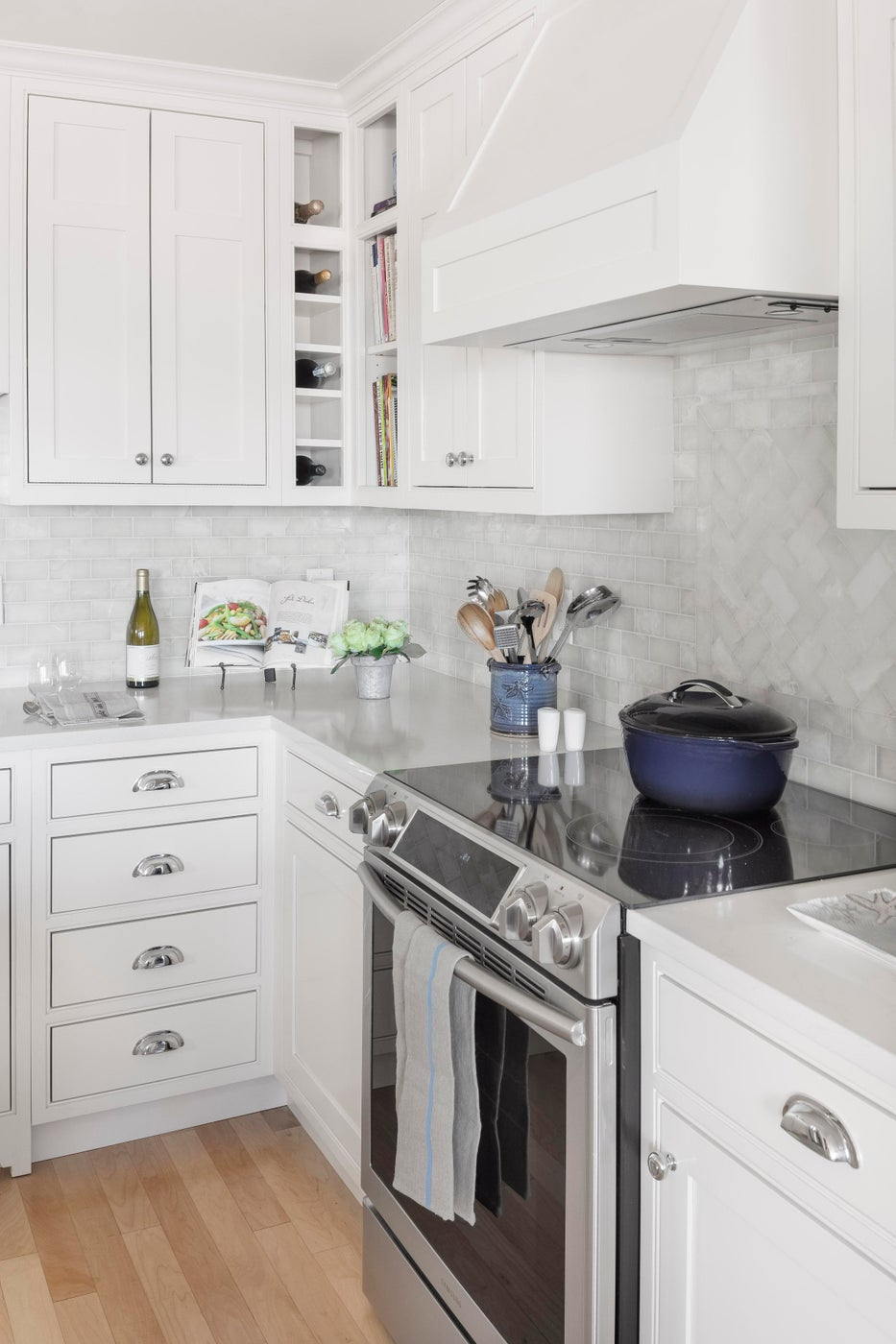 White and bright kitchen for chefs and sommeliers