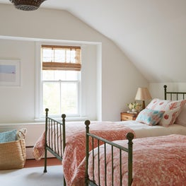 Hamptons Beach house guest bedroom with charm!