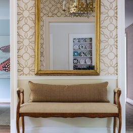 Entry Hall with graphic grasscloth wallcovering and antique French bench