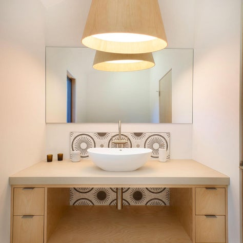 Scandi Light, light wood pendant and open vanity with bold patterned tile