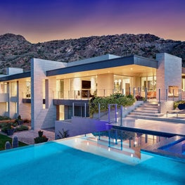 Architectural planes pierce translucent living spaces of this desert residence.