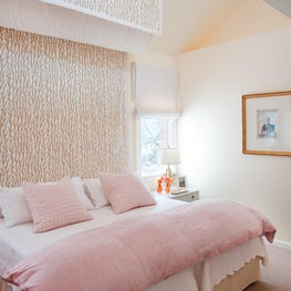 Coastal bedroom with embroidered coral bed canopy and ship's ladder to loft area