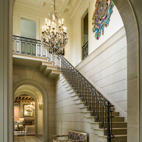 Classical Stair Hall with cut-stone detailing and cast bronze stair railing.