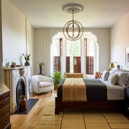 Hudson Street Brownstone I Bedroom | Marble Fireplace | Vintage Mix